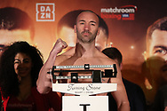 March 8, 2019; Verona, NY, USA; Seanie Monaghan steps on the scale to weigh in for his bout at the Turning Stone Resort and Casino in Verona, NY.  Mandatory Credit: Ed Mulholland/Matchroom Boxing USA