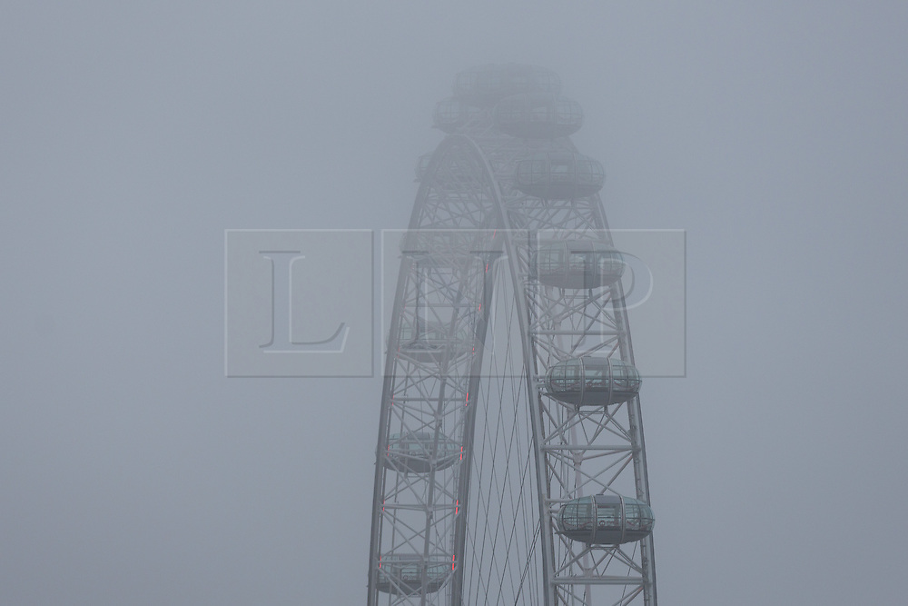 © Licensed to London News Pictures. 07/01/2017. LONDON, UK.  The top of the London Eye is shrouded in fog and mist this morning. The weather in London today is misty, foggy and much milder than it has been during the past week.  Photo credit: Vickie Flores/LNP