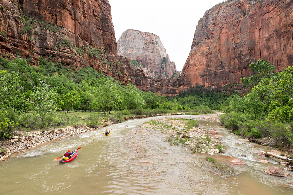 Paddling inflatable kayaks down the North Fork Virgin River in Zion National Park, Utah.