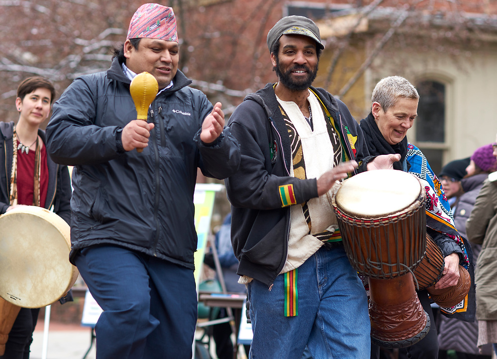 Lawrence Green, an Athens resident and African drum and dance instructor marches in the parade of flags with other international residents.