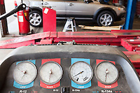 Close-up of a hoist pressure gauge in garage