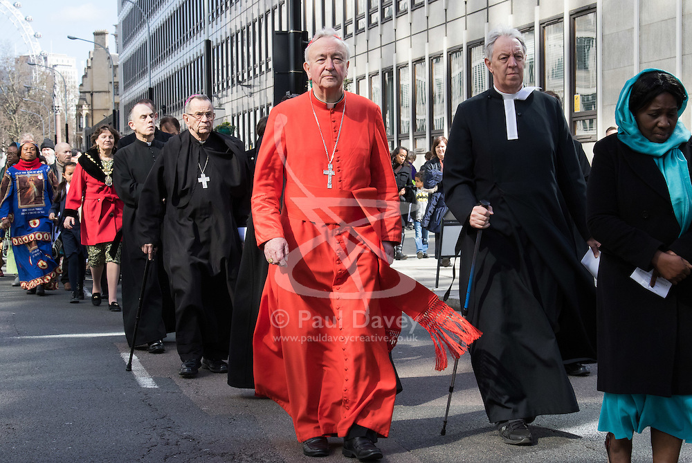 Westminster, London, March 25th 2016. Westminster's annual interdenominational Easter procession takes place with a procession from Methodist Central Hall to Westminster Cathedral and then on to Westminster Abbey, with the cross borne by people from The Passage, a homeless charity. PICTURED: The Archbishop of Westminster Cardinal Vincent Nichols leads the procession along with other members of the clergy. <br /> ©Paul Davey<br /> FOR LICENCING CONTACT: Paul Davey +44 (0) 7966 016 296 paul@pauldaveycreative.co.uk