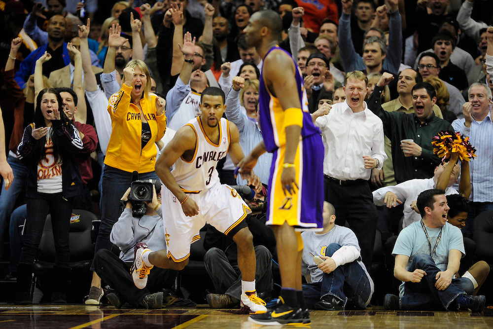 Feb. 16, 2011; Cleveland, OH, USA; The Cleveland Cavaliers fans celebrate after Cleveland Cavaliers point guard Ramon Sessions (3) scored during the fourth quarter against the Los Angeles Lakers at Quicken Loans Arena. The Cavaliers beat the Lakers 104-99. Mandatory Credit: Jason Miller-US PRESSWIRE