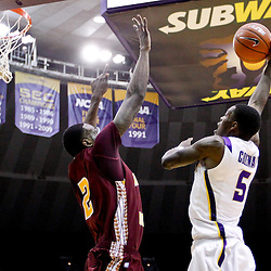 Jan 5, 2013; Baton Rouge, LA, USA; LSU Tigers forward Shavon Coleman (5) shoots over Bethune-Cookman Wildcats forward Alex Smith (2) during the second half of a game at the Pete Maravich Assembly Center. LSU defeated Bethune-Cookman 79-63. Mandatory Credit: Derick E. Hingle-USA TODAY Sports