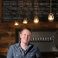 General Manager Andrew Bopes, photographed at Palate Bottle Shop & Reserve in Wilmington, NC on Tuesday, March 31, 2015. Photo by Michael Cline Photography