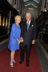 RUPERT & ROBIN HAMBRO at a party to celebrate the opening of luxury jewellers Nourbel & Le Cavelier first boutique in London in Burlington Arcade, London on 14th June 2012.