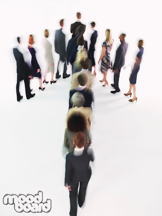 Group of Businesspeople walking in arrow formation