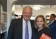 Rockville Centre, New York, USA. April 201, 2018. L-R, Rep. STEVE ISRAEL and Town of Hempstead Supervisor LAURA GILLEN pose for photo at special event for Nassau County debut of the former Congressman's (NY - Dem) newest novel BIG GUNS - a satire of the strong gun lobby, weak Congress, and a small Long Island town. The talk and book signing was held at Turn of the Corkscrew Books & Wine store.