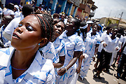Members of the #2 Asafo company dance as they follow their chief during the parade held on the occasion of the annual Oguaa Fetu Afahye Festival in Cape Coast, Ghana on Saturday September 6, 2008..