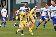 Millwall Midfielder, Ben Thompson and Bury Midfielder, Tom Soares in action during the Sky Bet League 1 match between Bury and Millwall at the JD Stadium, Bury, England on 23 April 2016. Photo by Mark Pollitt.