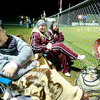 Thomas Wells | BUY AT PHOTOS.DJOURNAL.COM<br /> Susan Barrett, from left, her daughter, Morgan, 18, and Breanna Sloan, 17, gather around a infrared propane heater before the Smithville football game against Kennedy High School onFrdiay.