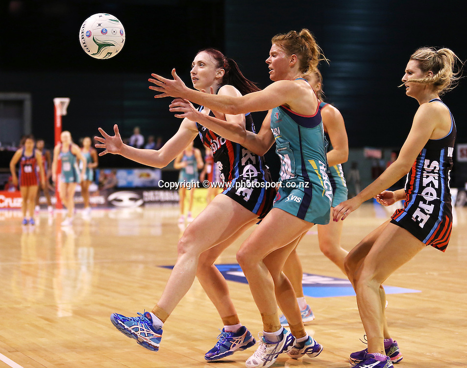 Jade Clarke of the Tactix competes for the ball with Tegan Caldwell of the Vixens during the ANZ Championship Netball between Mainland Tactix v Melbourne Vixens, held at CBS Arena, Christchurch. 31 March 2014 Photo: Joseph Johnson/www.photosport.co.nz