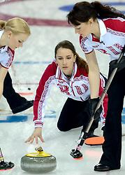 12-02-2014 CURLING: OLYMPIC GAMES: SOTSJI<br /> Japan verslaat Rusland met 8-4. Alexandra Saitova, Anna Sidorova, Ekaterina Galkina<br /> ©2014-FotoHoogendoorn.nl