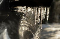 Icicles on a car mirror.
