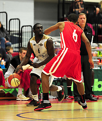 Essex Leopards' Simon Cummings attempts to dribble past Bristol Academy Flyers' Dwayne Laugier-Ogunleye - Photo mandatory by-line: Dougie Allward/JMP - Tel: Mobile: 07966 386802 23/03/2013 - SPORT - Basketball - WISE Basketball Arena - SGS College - Bristol -  Bristol Academy Flyers V Essex Leopards