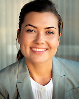 Corporate Headshot of Grace Riley.