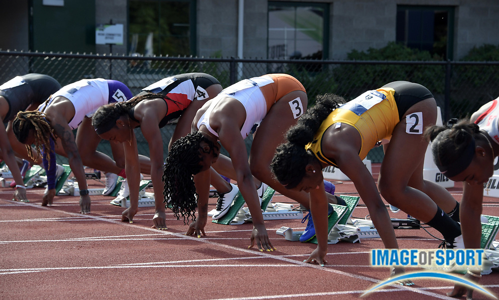 Jun 7, 2018; Eugene, OR, USA; Sprinters in the starting blocks of a women's 100m heat during the NCAA Track and Field championships at Hayward Field.Fro right:  Brittany Brown (Iowa), Teahna Daniels (Texas), Ashley Henderson (San Diego State), Aleia Hobbs (LSU), Kianna Gray (Kentucky), Natalliah Whyte (Auburn) and Jonielle Smith (Auburn).