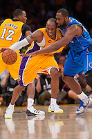 02 April 2013: Guard (24) Kobe Bryant of the Los Angeles Lakers has the ball knocked away by (42) Elton Brand of the Dallas Mavericks during the first half of the Lakers 101-81 victory over the Mavericks at the STAPLES Center in Los Angeles, CA.