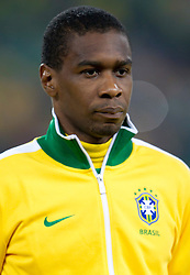 Juan of Brazil listening to the national anthem during the 2010 FIFA World Cup South Africa Group G Second Round match between Brazil and République de Côte d'Ivoire on June 20, 2010 at Soccer City Stadium in Soweto, suburban Johannesburg, South Africa.  Brazil defeated Ivory Coast 3-1. (Photo by Vid Ponikvar / Sportida)