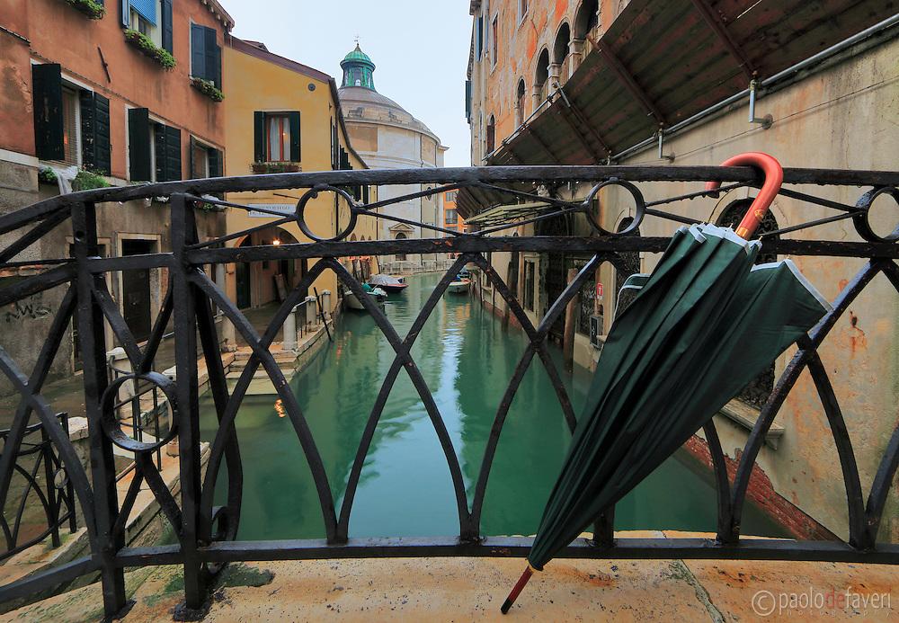 A rainy day - with acqua alta - at Rio della Maddalena in Venice, Italy, with the Maddalena church in the background