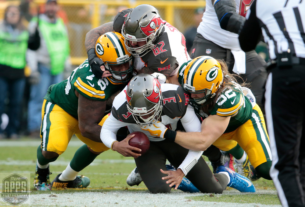 Green Bay Packers defensive end Mike Daniels (76) and Green Bay Packers outside linebacker Clay Matthews (52) sacked Tampa Bay Buccaneers quarterback Jameis Winston (3) for a 8-yard loss in the 2nd quarter.<br /> The Green Bay Packers hosted the Tampa Bay Buccaneers at Lambeau Field in Green Bay,  Sunday, Dec. 3, 2017.  STEVE APPS FOR THE STATE JOURNAL.