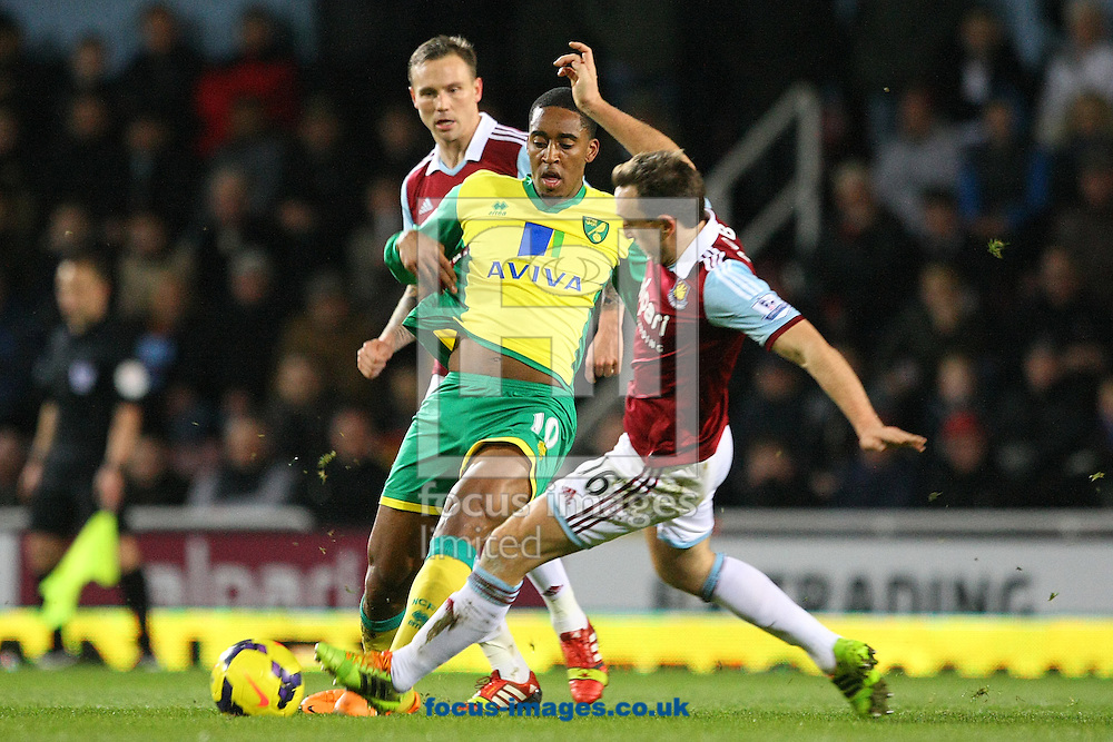 Picture by Paul Chesterton/Focus Images Ltd +44 7904 640267<br /> 11/02/2014<br /> Leroy Fer of Norwich and Mark Noble of West Ham in action during the Barclays Premier League match at the Boleyn Ground, London