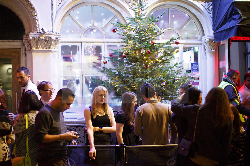 """© licensed to London News Pictures. London, UK 14/12/2013. """"Mad Friday"""" revellers in Soho, London enjoy the last Friday night out before Christmas, which is also the busiest night of the year for emergency services. Photo credit: Tolga Akmen/LNP"""