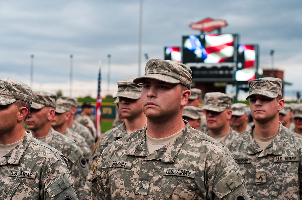 Lathan Goumas | ..Members of Army National Guard Company Fox 237, Brigade Support Battalion, march into Dow Diamond during a deployment ceremony in Midland, MI., on Monday September 26, 2011.
