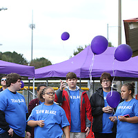 Attendees of Saturday's Out of the Darkness Walk released balloons to remember those who were lost to suicide