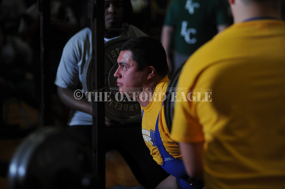 Christian Sanchez squats during Class 5A Region weightlifting competition at Oxford High School in Oxford, Miss. on Saturday, February 9, 2013.