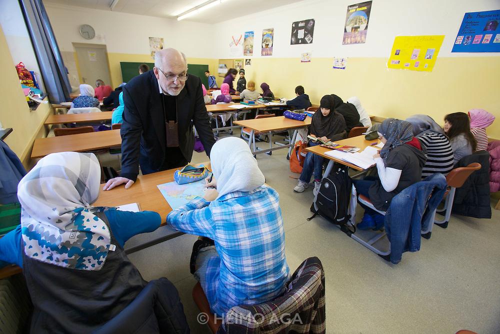 """Vienna. Islamic Gymnasium Vienna(Islamisches Realgymnasium Wien). School director Mr. Sommer with girls wearing """"Hijabs"""" (headscarfs)."""