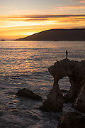 Silhouette of a Girl Standing on the Arch at Pirates Cove Avila Beach