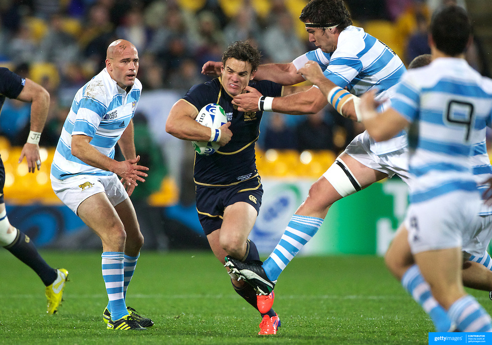 Max Evans, Scotland, is tackled during the Argentina V Scotland, Pool B match at the IRB Rugby World Cup tournament. Wellington Regional Stadium, Wellington, New Zealand, 25th September 2011. Photo Tim Clayton...