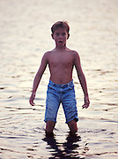Adam Pratt wading in shallow water at Arcadia Lake.  My first published picture.