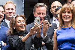 © Licensed to London News Pictures. 23/06/2015. London, UK. DAVID CAMERON poses for selfies at the launch of the Start-Up Britain campaign routemaster bus in Downing Street, London with Prime Minister, David Cameron. Over five weeks the routemaster bus will visit 30 towns and cities - including Aberdeen, Inverness, Swansea York and Leeds - and aim to engage with 15,000 individuals through workshops and networking events, making them aware of the assistance Start-Up Britain can offer. Photo credit : Vickie Flores/LNP