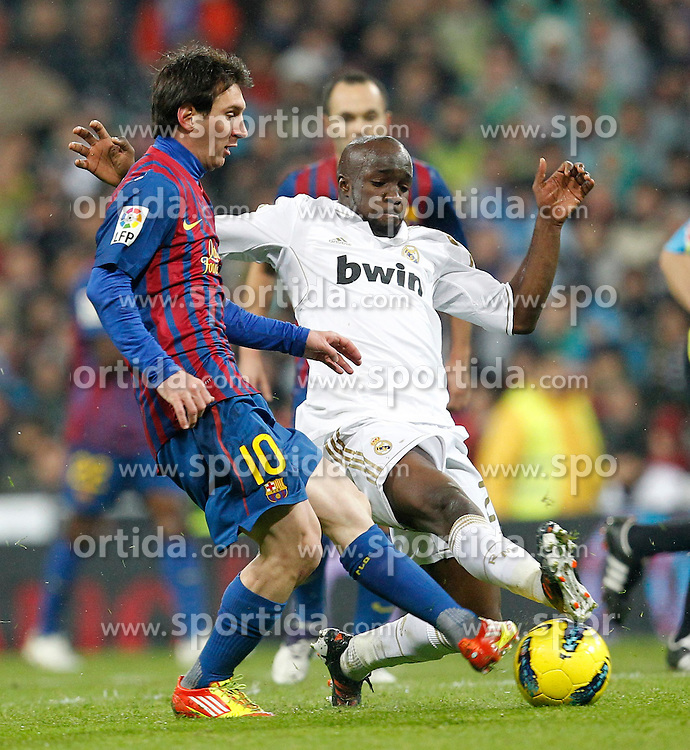 10.12.2011, Santiago Bernabeu Stadion, Madrid, ESP, Primera Division, Real Madrid vs FC Barcelona, 15. Spieltag, im Bild Real Madrid's Lassana Diarra and FC Barcelona's Lionel Messi // during the football match of spanish 'primera divison' league, 15th round, between Real Madrid and FC Barcelona at Santiago Bernabeu stadium, Madrid, Spain on 2011/12/10. EXPA Pictures © 2011, PhotoCredit: EXPA/ Alterphotos/ Alex Cid-Fuentes..***** ATTENTION - OUT OF ESP and SUI *****