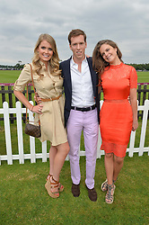 Left to right, LADY KITTY SPENCER, MAXI CARELLO and LADY JEMIMA HERBERT at the Cartier Queen's Cup Polo final at Guard's Polo Club, Smiths Lawn, Windsor Great Park, Egham, Surrey on 14th June 2015