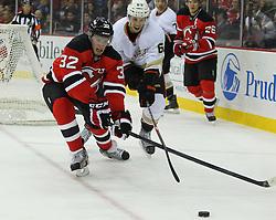 Feb 17; Newark, NJ, USA; New Jersey Devils defenseman Matt Taormina (32) and Anaheim Ducks center Nick Bonino (63) during the second period at the Prudential Center.