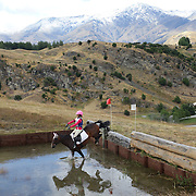 Benna Catterick riding Timaunga Skylark in action at the water jump during the Cross Country event at the Wakatipu One Day Horse Trials at the Pony Club grounds,  Queenstown, Otago, New Zealand. 15th January 2012. Photo Tim Clayton