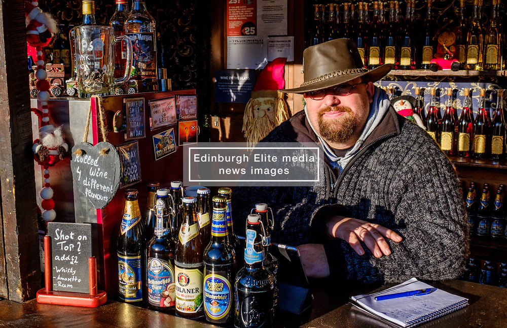 Edinburgh's Christmas 2019: A stall holder in Princes Street Gardens waiting on customers for his beer.