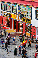 Tibetan pilgrims circumambulating through Barkhor Square and along The Barkhor, Lhasa, Tibet (Xizang), China.