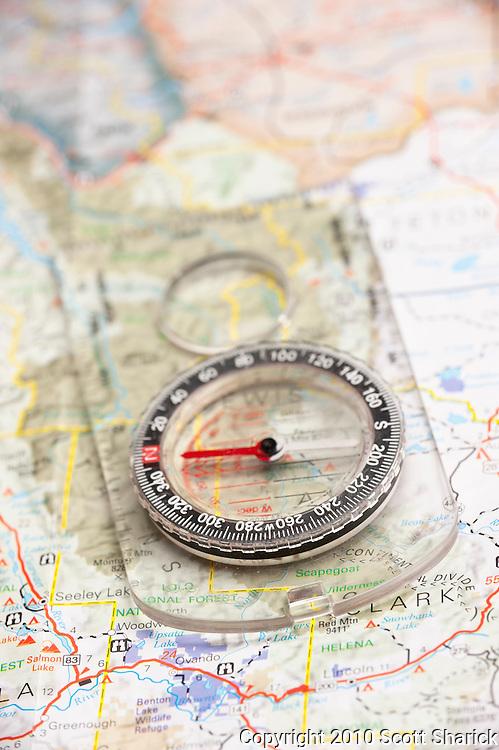 A compass helps guide the traveler along a map. Missoula Photographer