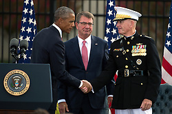 Remember 9/11: US Pr‰sident Barack Obama bei einer Gedenkveranstaltung am Pentagon<br /> <br /> / 110916<br /> <br /> *** U.S President Barack Obama shakes hands with Chairman of the Joint Chiefs Gen. Joseph F. Dunford Jr., as Defense Secretary Ash Carter looks on after a ceremony commemorating the 15th anniversary of the 9/11 terrorist attacks at the Pentagon September 11, 2016 in Arlington, Virginia.  ***