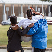 OXON HILL, MD-OCT20: Lakisha Jenkins, the mother of  Keyshaun Mason,14, who was stabbed to death by her live-in boyfriend,  collapsed in grief and is carried to her car, following a press conference outside Potomac High School in Oxon Hill, MD, October 20, 2105. During a domestic dispute, Lakisha Jenkins, was barricaded in the master bedroom of her home by her live-in boyfriend, 48-year-old Sean Crawford. Crawford was armed with a kitchen knife. Keyshaun Mason, 14, and his 18-year-old brother attempted to enter the master bedroom to ask Crawford to leave their home. According to the documents, Crawford then stabbed Keyshaun in the chest. Both teens were taken to a local hospital where Keyshaun was pronounced dead. His brother was treated at the hospital and released. (Photo by Evelyn Hockstein/For The Washington Post)