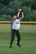 Left fielder Allison Gallagher catches a fly ball in the first inning during a game against Gibbstown held at the Clayton Little League Complex Thursday July 7, 2011.