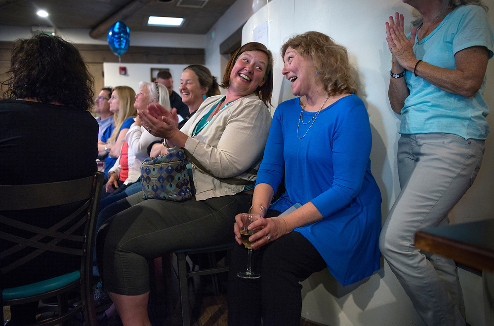 em050817f/a/Kate Diaz, left, the principal at Atalaya Elementary School laughs with Gail Ansheles, a kindergarten teacher at El Dorado Community School, as they watch Asheles compete on the Jeoparty game show during a watch party in Santa Fe, Monday May 8, 2017. Asheles won and moves on to another round. (Eddie Moore/Albuquerque Journal