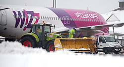 © Licensed to London News Pictures. 05/02/2012. Luton, UK. A snow plough removing snow from the runway at  Luton airport, Bedfordshire, on February 5th, 2012. . Photo credit : Ben Cawthra/LNP