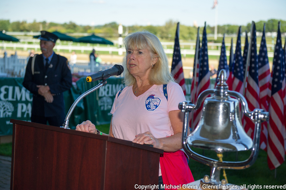 1 Oct 2017 Elmont, New York United States of America // FDNY Dr. Kerry Kelly reads off the name of the fallen she climbed in memory of, and rings the bell, at the end of the 3RD annual national stair climb for fallen firefighters at the Belmont Park racetrack  Michael Glenn  /   for the FDNY