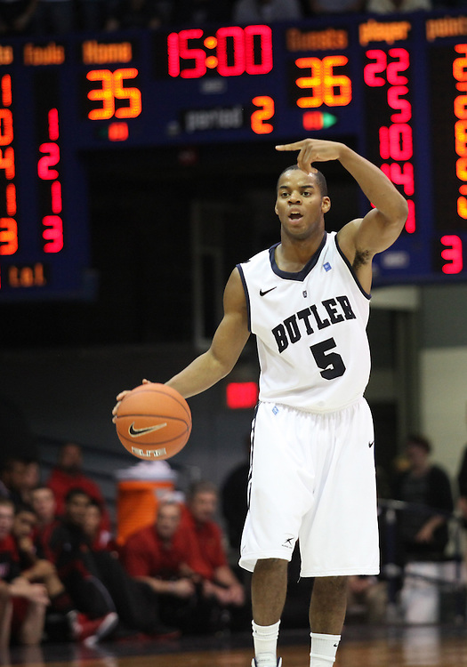 November 19, 2011: Butler's Ronald Nored instructs teammates in the first half of the game against Louisville at Hinkle Fieldhouse in Indianapolis, Ind. Louisville won 69-53.