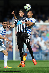 Queens Park Rangers' Karl Henry challenges for the header with Newcastle United's Ayoze Perez - Photo mandatory by-line: Dougie Allward/JMP - Mobile: 07966 386802 - 16/05/2015 - SPORT - football - London - Loftus Road - QPR v Newcastle United - Barclays Premier League